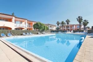 Zwembad van Residence La Palmeraie in Grimaud, Frankrijk