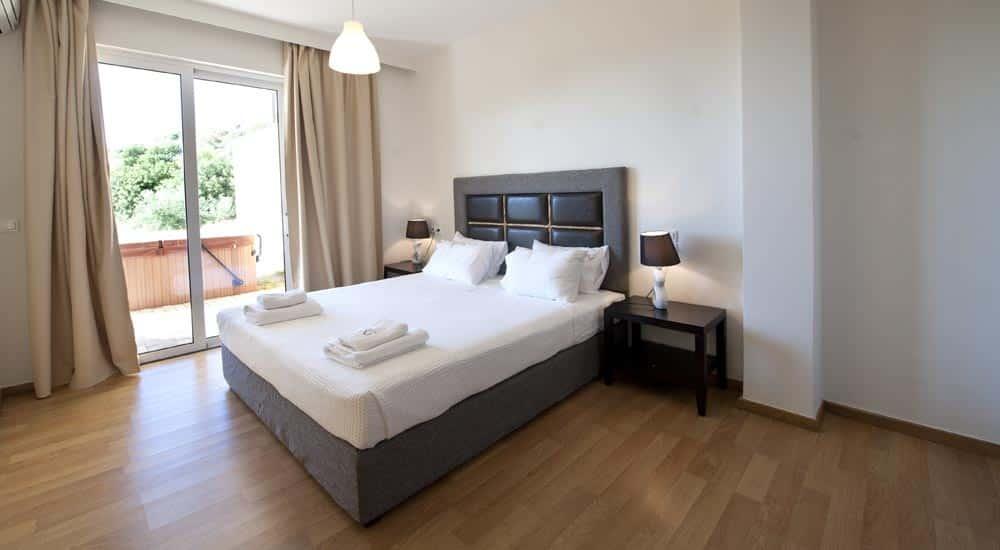 Slaapkamer van Rimondi Grand Resort & Spa in Stavromenos, Kreta