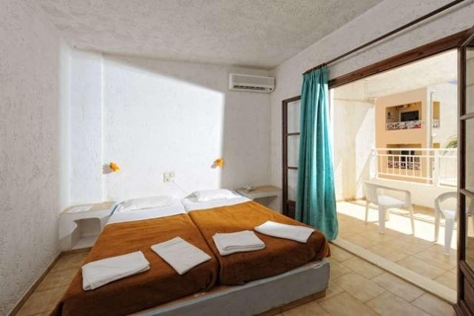 Slaapkamer van appartement van Appartementen Neptune in Chersonissos, Kreta
