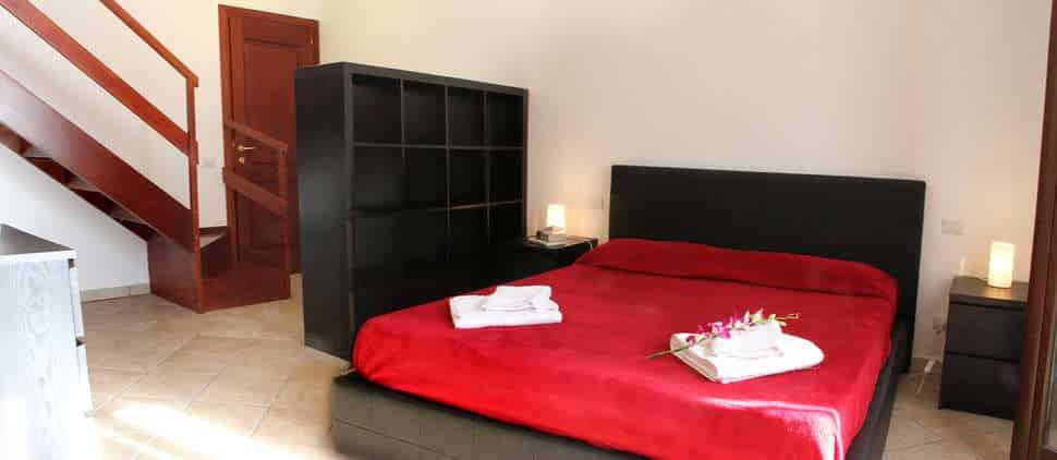 Slaapkamer van Appartementen Cefalù Centro in Cefalù, Italië