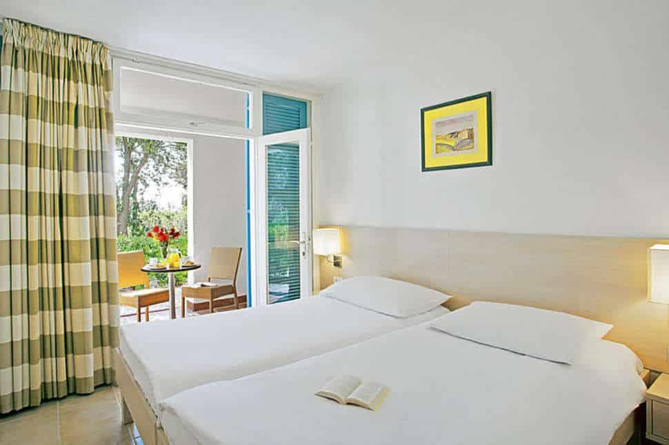 Slaapkamer van appartement van appartementen Laterna in Porec, Kroatie
