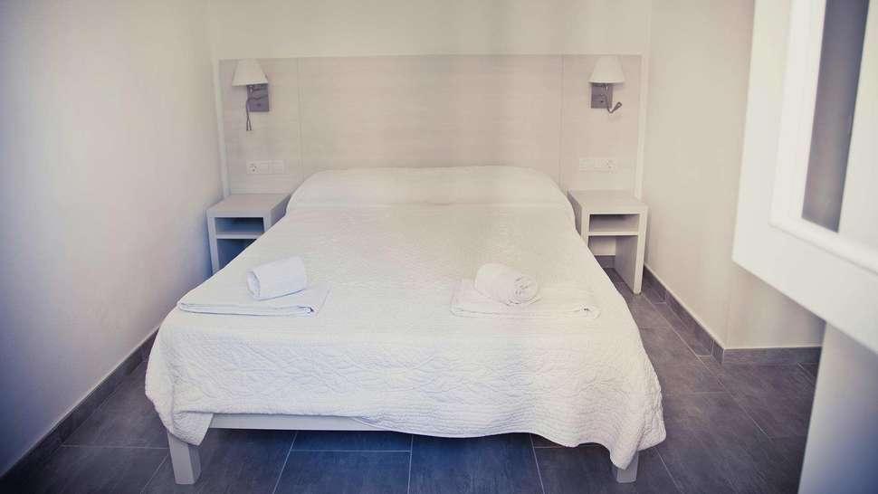 Slaapkamer van appartement van Playa Ferrera in Cala d'Or, Mallorca