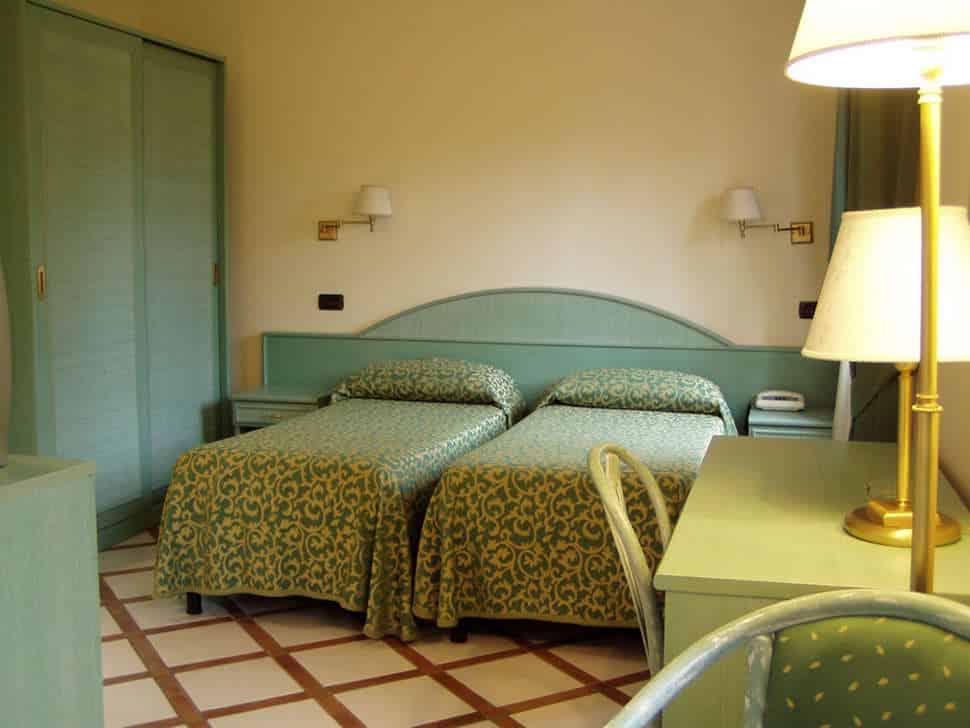 Slaapkamer in Bungalow van Villagio Verde in Sorrento, Italië