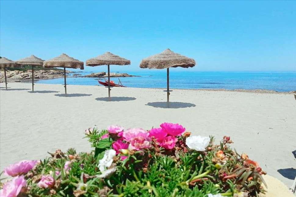 Strand van Villagio Porto Corallo in Porto Corallo, Sardinië
