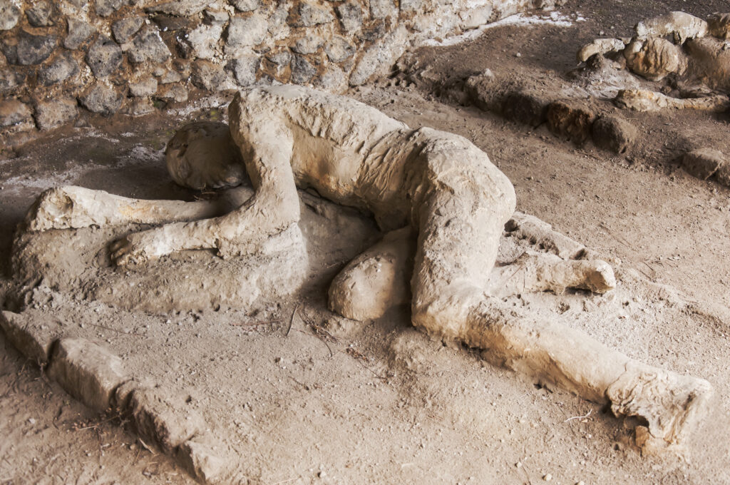 Mens bedekt onder het puin in Pompeii