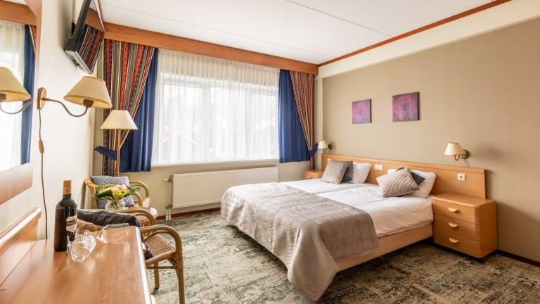Hotelkamer van hotel De Klok