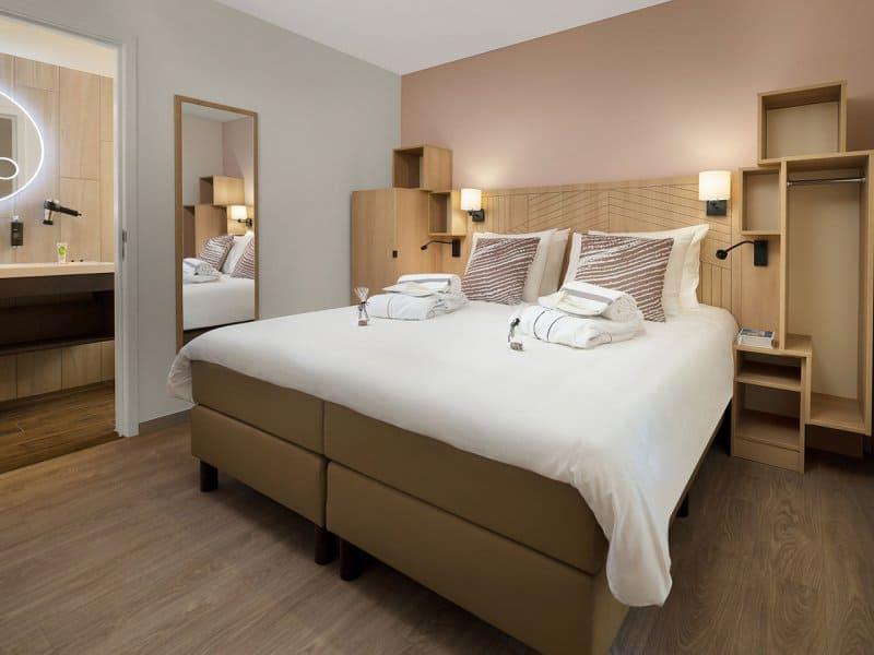 Slaapkamer in een cottage van Center Parcs Terhills Resort